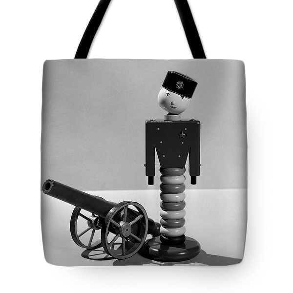 1930s Wooden Toy Soldier Next To Cannon Tote Bag