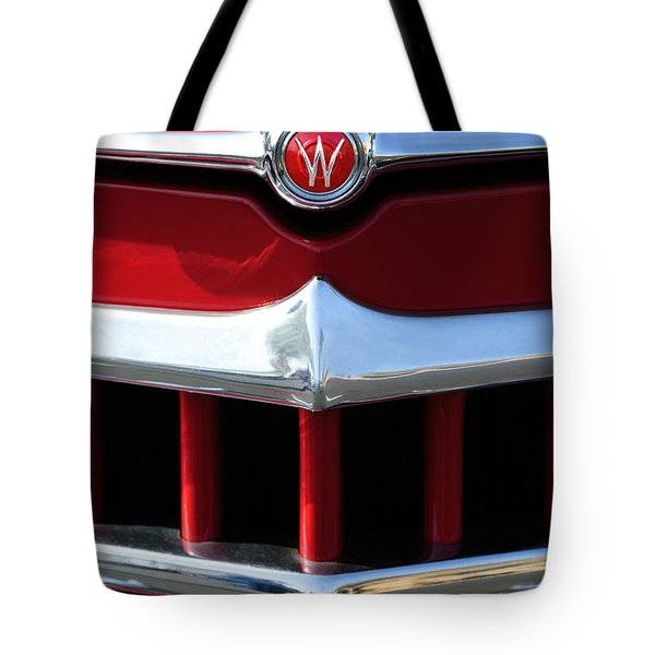 Tote Bag featuring the photograph 1950 Willys Overland Jeepster Hood Emblem by Jill Reger