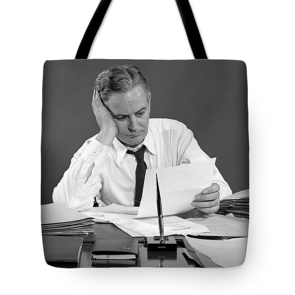 1950s Businessman At Desk Reading Tote Bag
