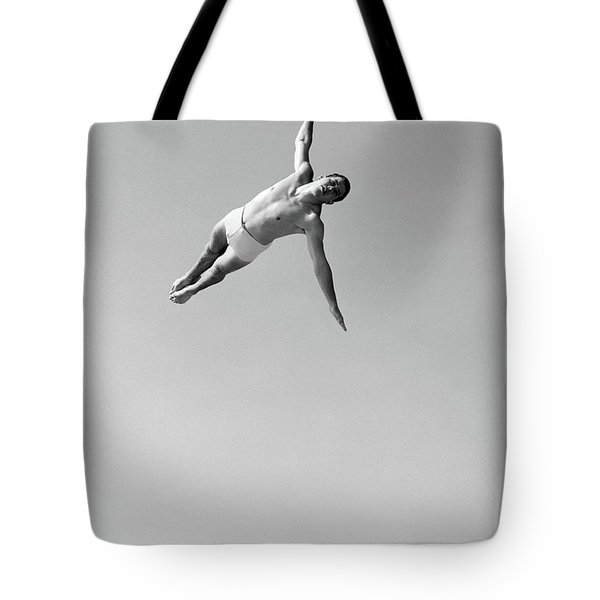 1950s Man Twisting Swan Diving Tote Bag