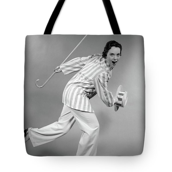 1950s Woman In Striped Jacket Holding Tote Bag