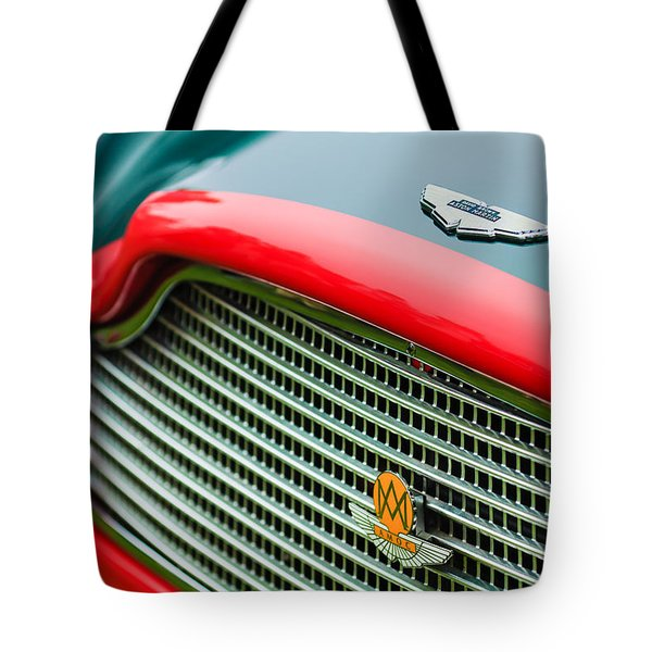 1960 Aston Martin Db4 Gt Coupe' Grille Emblem Tote Bag by Jill Reger