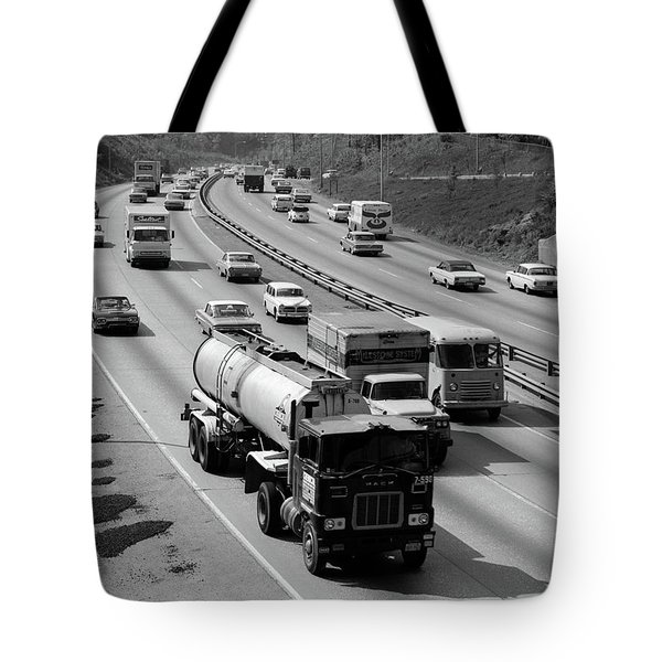 1960s Tanker Truck Traveling On Busy Tote Bag