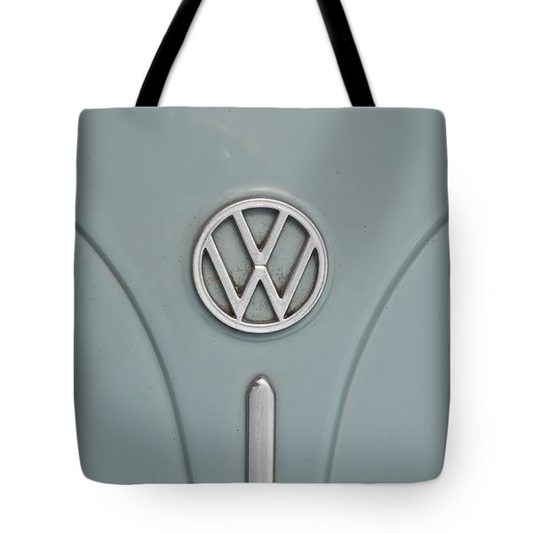 Tote Bag featuring the photograph 1965 Volkswagen Beetle Hood Emblem by Jani Freimann