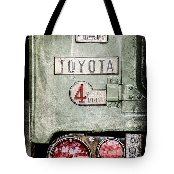 Tote Bag featuring the photograph 1969 Toyota Fj-40 Land Cruiser Taillight Emblem -0417ac by Jill Reger