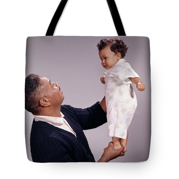 1970s African American Father Holding Tote Bag