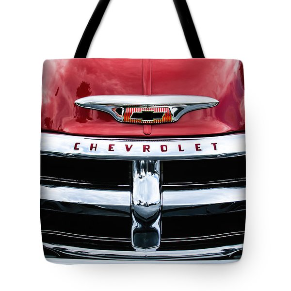 Tote Bag featuring the photograph 1955 Chevrolet 3100 Pickup Truck Grille Emblem by Jill Reger