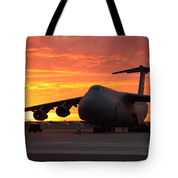 A C-5 Galaxy Sits On The Flightline Tote Bag