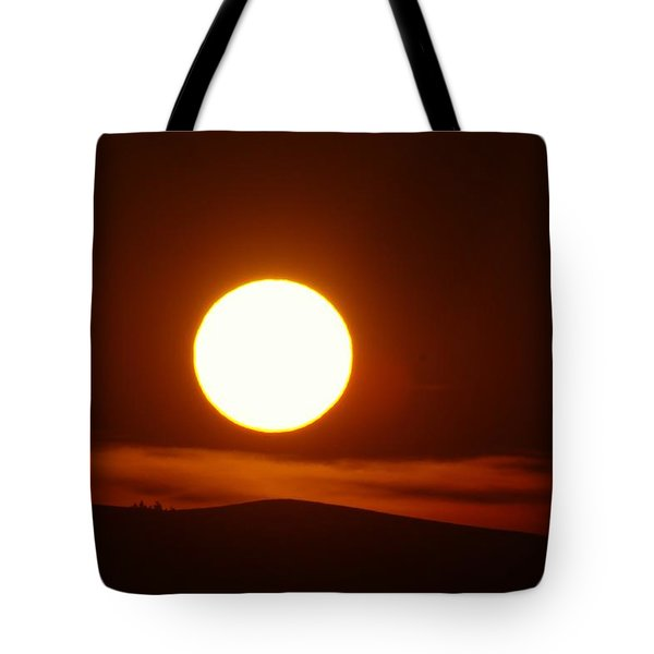 A Slow Red Sunset Tote Bag by Jeff Swan