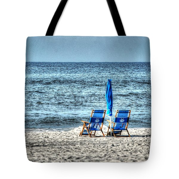 Tote Bag featuring the digital art 2 Chairs And Umbrella by Michael Thomas