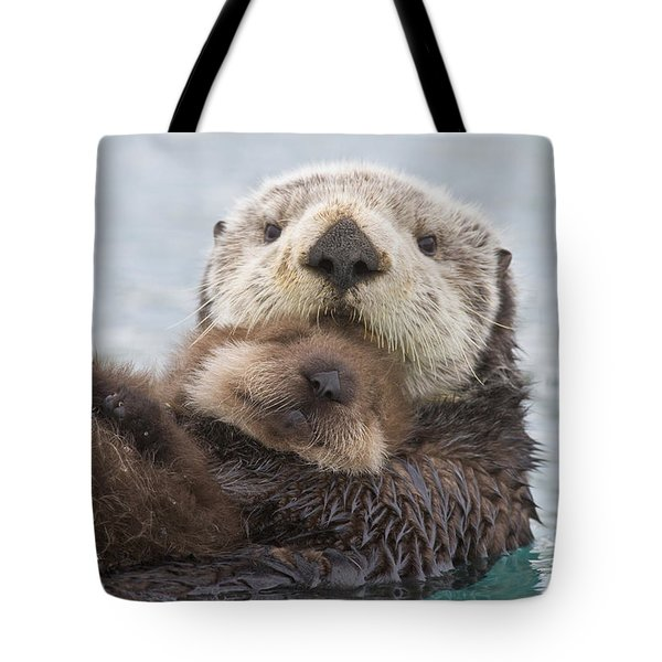 Female Sea Otter Holding Newborn Pup Tote Bag