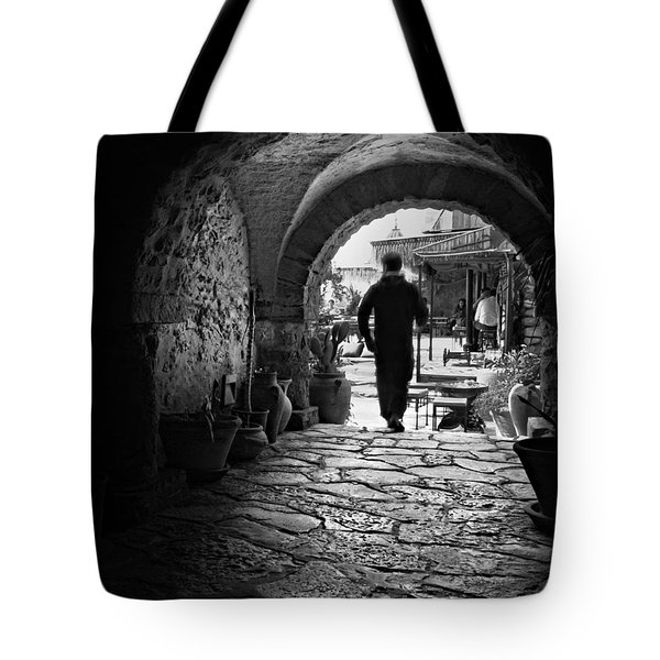 Tote Bag featuring the photograph Man In An Archway / Hammamet by Barry O Carroll