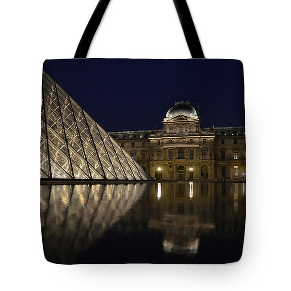 The Louvre Palace And The Pyramid At Night Tote Bag