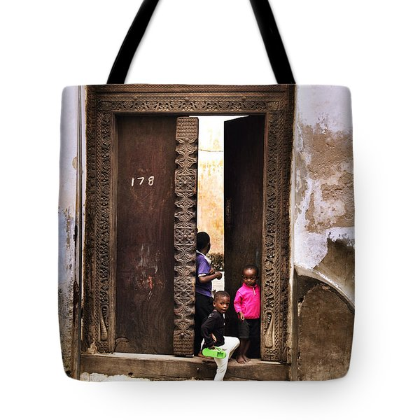 Tote Bag featuring the photograph Kids Playing Zanzibar Unguja Doorway by Amyn Nasser