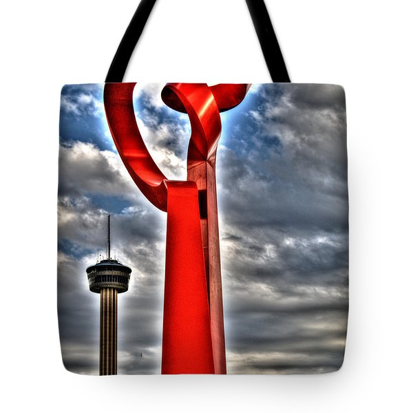 Tote Bag featuring the sculpture Torch Of Friendship by Deborah Klubertanz
