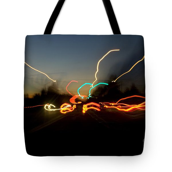 Tote Bag featuring the photograph Traffic Blur by Charmian Vistaunet