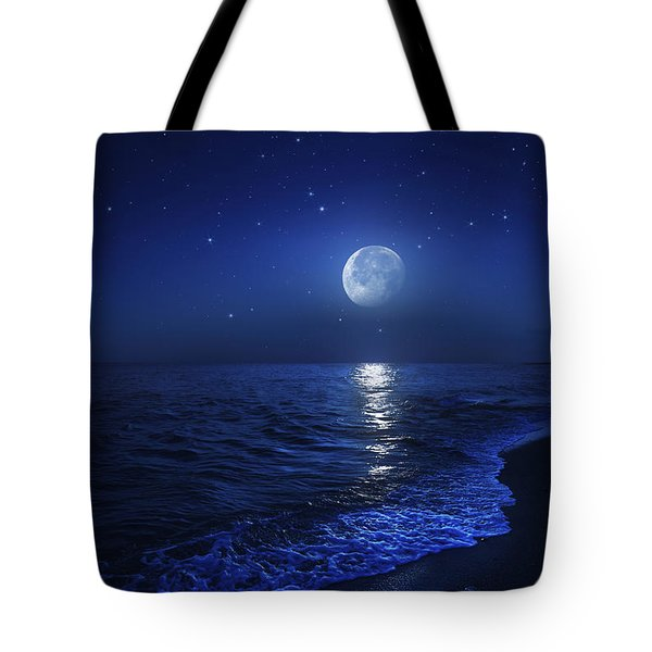 Tranquil Ocean At Night Against Starry Tote Bag by Evgeny Kuklev