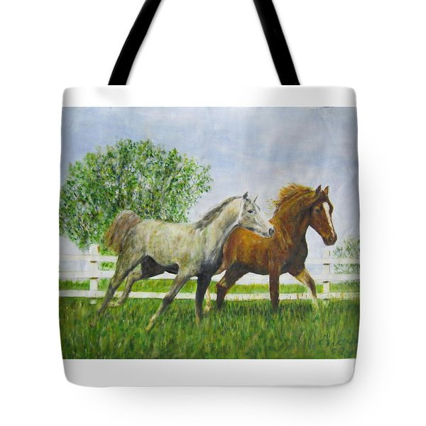 Two Horses Running By White Picket Fence Tote Bag