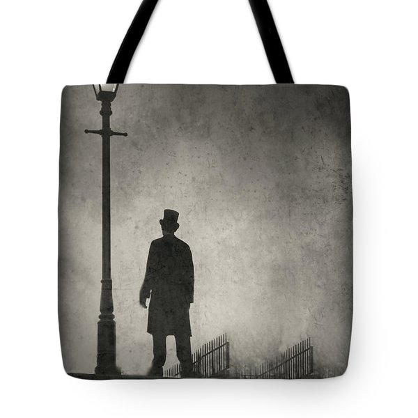 Victorian Man Standing Next To An Illuminated Gas Lamp Tote Bag by Lee Avison