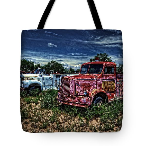 Tote Bag featuring the photograph 3 In A Row by Ken Smith