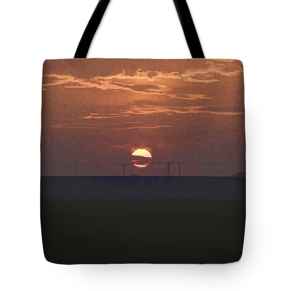 The Setting Sun In The Distance With Clouds Tote Bag