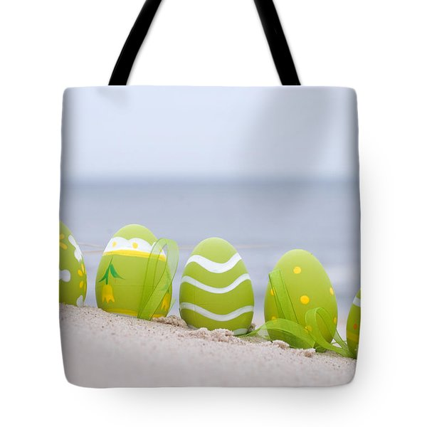 Easter Decorated Eggs On Sand Tote Bag by Michal Bednarek