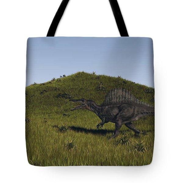 Spinosaurus Walking Across A Grassy Tote Bag by Kostyantyn Ivanyshen