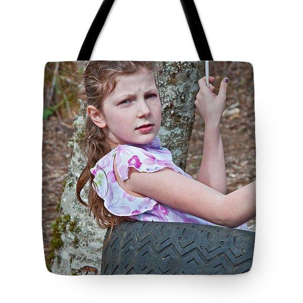 9 Year Old Caucasian Girl In Tire Swing Tote Bag