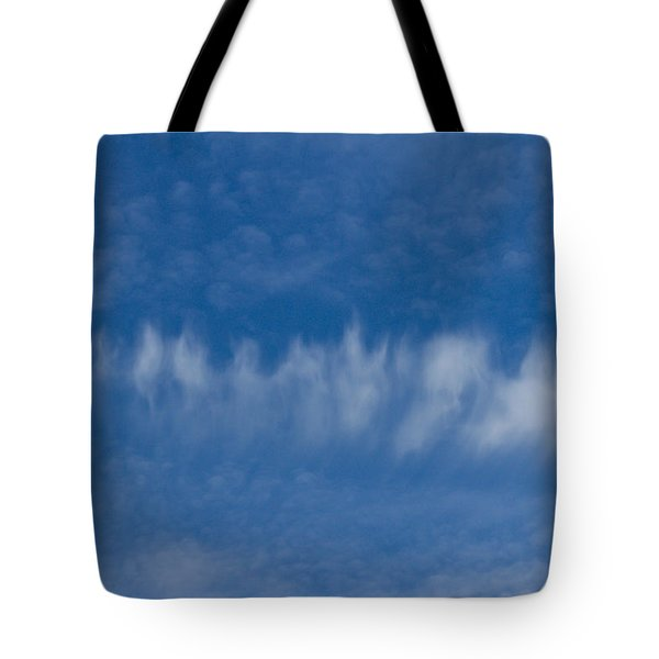 Tote Bag featuring the photograph A Batch Of Interesting Clouds In A Blue Sky by Eti Reid