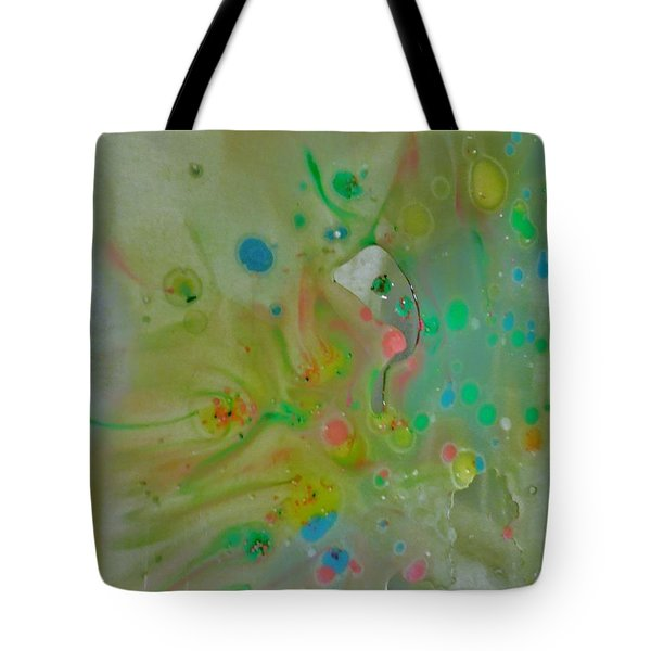 Tote Bag featuring the photograph A Bird In Flight by Robin Coaker