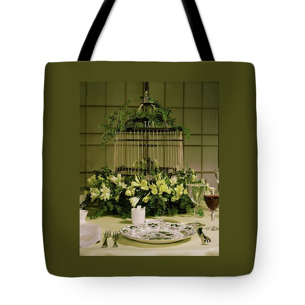 A Birdcage In The Middle Of A Table Tote Bag