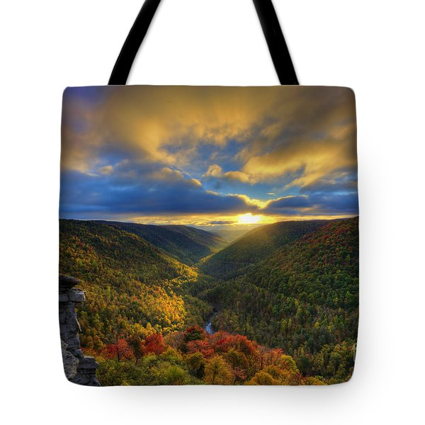 A Blue And Gold Sunset Tote Bag by Dan Friend
