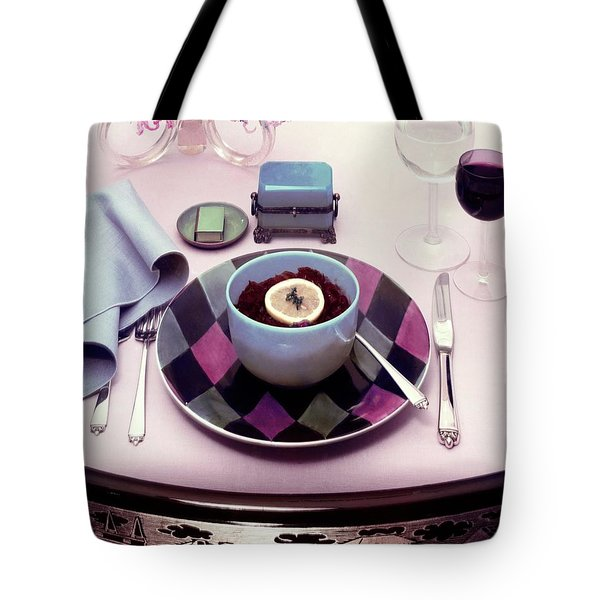 A Bowl Of Food On A Pink Table Tote Bag