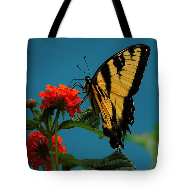 Tote Bag featuring the photograph A Butterfly by Raymond Salani III