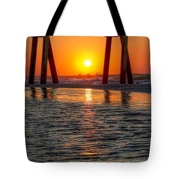 A Captive Sunrise Tote Bag by Tim Stanley