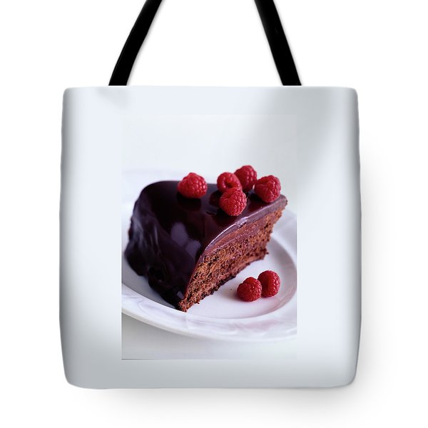 A Chocolate Pecan Cake With Raspberries On Top Tote Bag