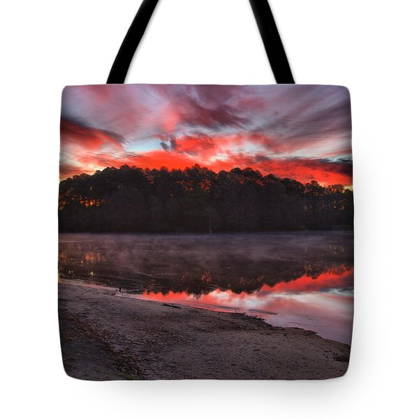 A Christmas Eve Sunrise Tote Bag by Gordon Elwell