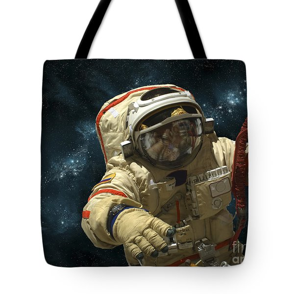A Cosmonaut Against A Background Tote Bag by Marc Ward
