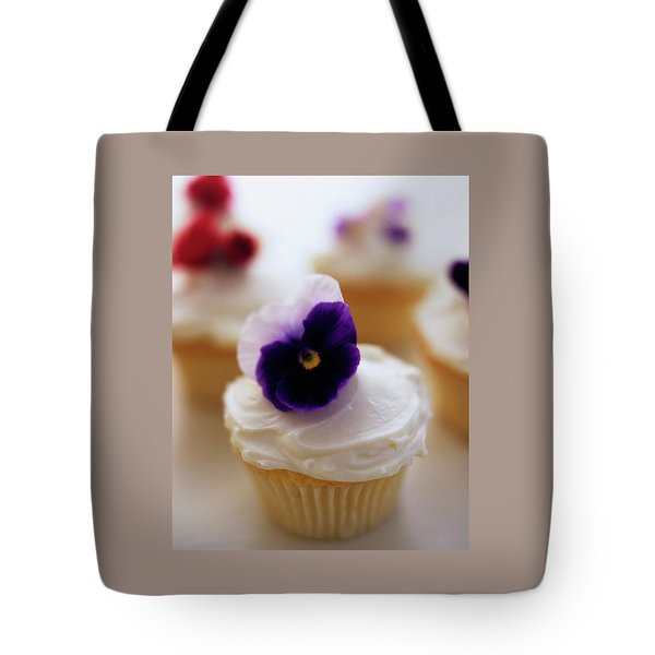 A Cupcake With A Violet On Top Tote Bag
