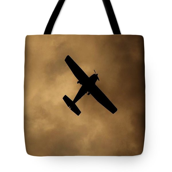 Tote Bag featuring the photograph A Dance In The Clouds by Jessica Shelton