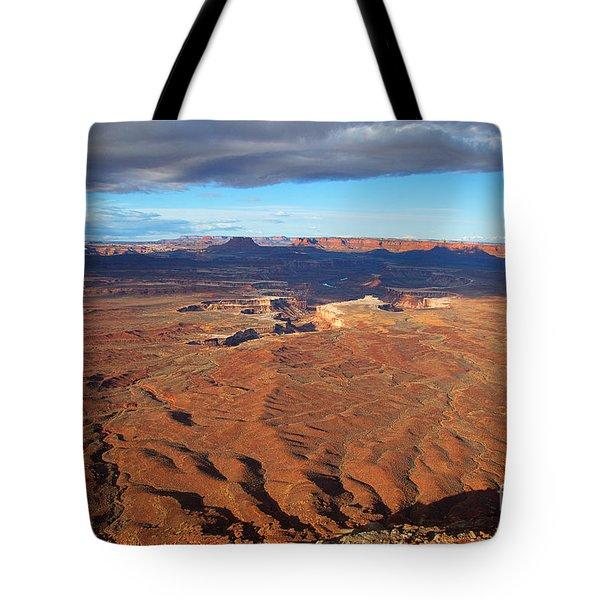 Tote Bag featuring the photograph A Dark Cloud Overhead by Jim Garrison