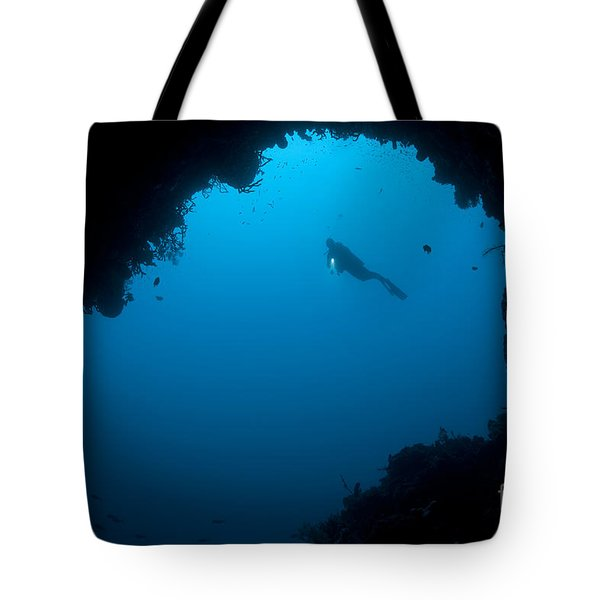A Diver Explores A Cavern In Gorontalo Tote Bag by Steve Jones