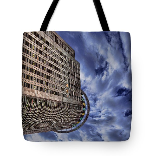 Tote Bag featuring the photograph A Drifting Skyscraper by Ron Shoshani