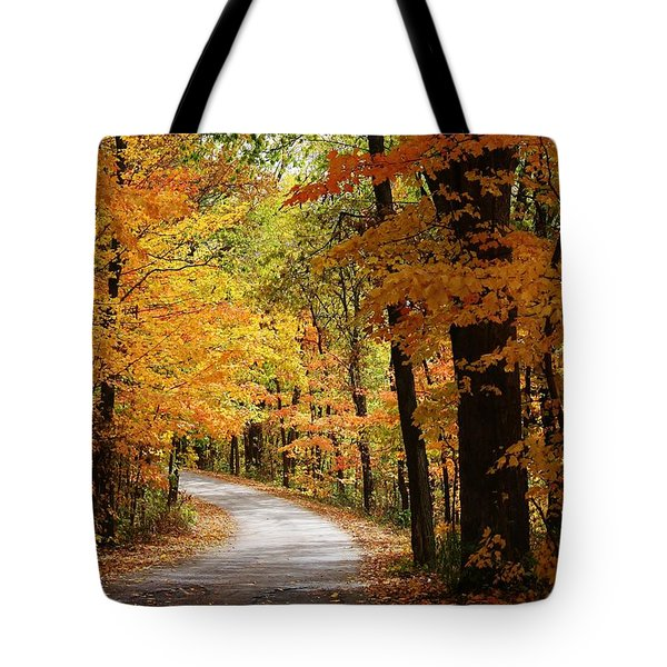 Tote Bag featuring the photograph A Drive Through The Woods by Bruce Bley