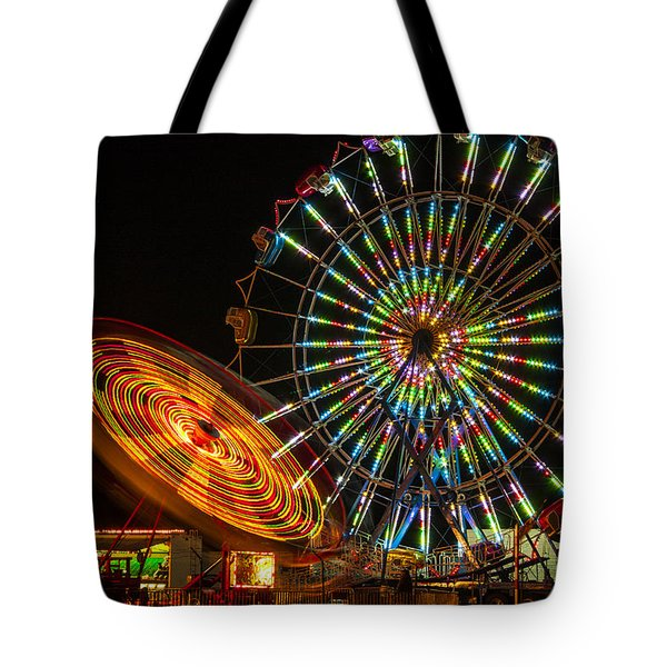 Tote Bag featuring the photograph Colorful Carnival Ferris Wheel Ride At Night by Jerry Cowart
