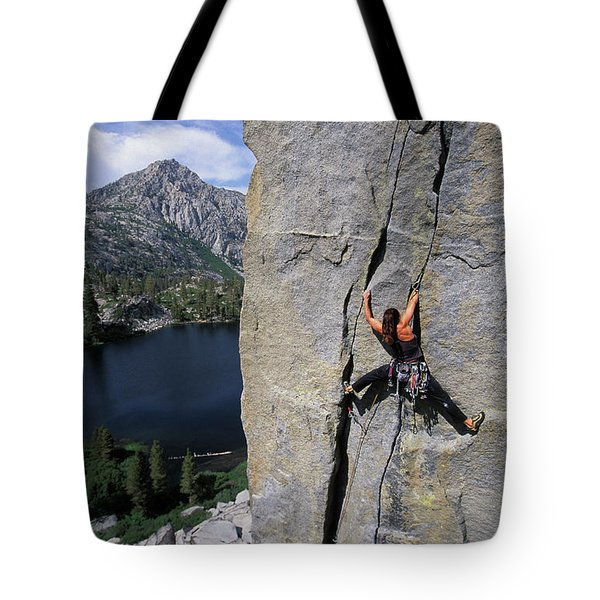 A Female Rock Climber Stemming While Tote Bag