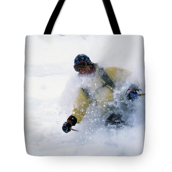 A Female Skier In Deep Powder Tote Bag