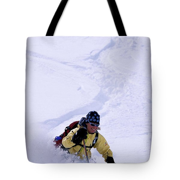 A Female Telemark Skier Skiing In Fresh Tote Bag