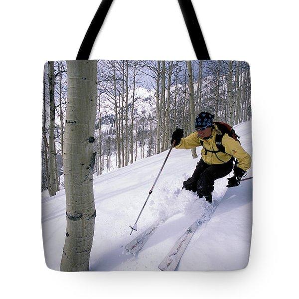 A Female Telemark Skier Tree Skiing Tote Bag