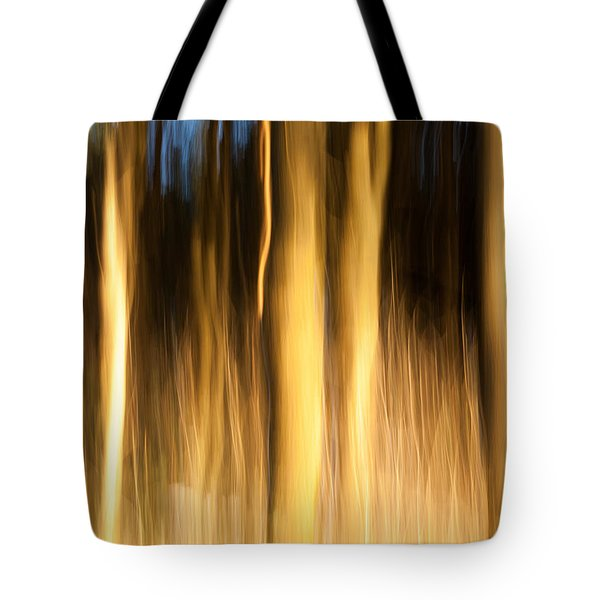 Tote Bag featuring the photograph A Fiery Forest by Davorin Mance